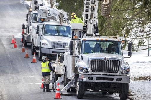 Crews from 3Phase Line Construction, from Chicago, work on War Trophy Lane in Aston, Pa., to try to bring back power to the residential neighborhood on Thursday, March 8, 2018. (Michael Bryant /The Philadelphia Inquirer via AP)