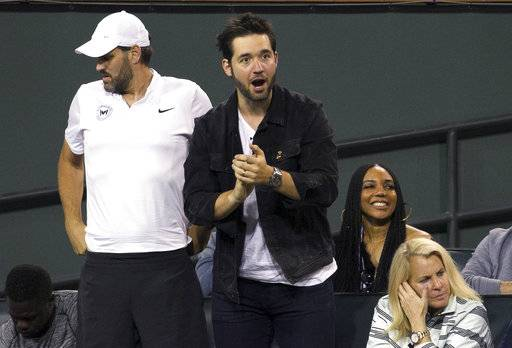 Serena Williams' husband, Alexis Ohanian, watches Williams play Zarina Diyas, of Kazakhstan, during the first round of the BNP Paribas Open tennis tournament in Indian Wells, Calif., Thursday, March 8, 2018.