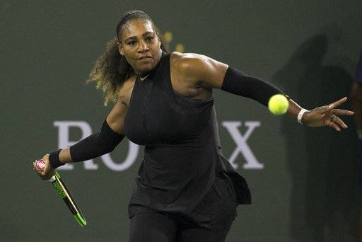 Serena Williams prepares to hit a forehand to Zarina Diyas during the first round of the BNP Paribas Open tennis tournament in Indian Wells, Calif., Thursday, March 8, 2018.