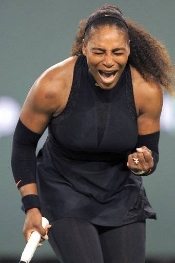 Serena Williams reacts while playing Zarina Diyas during the first round of the BNP Paribas Open tennis tournament in Indian Wells, Calif., Thursday, March 8, 2018.