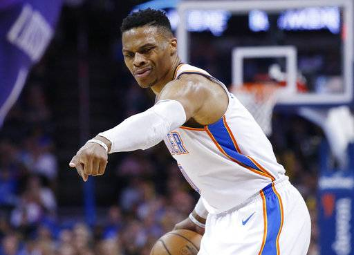 Oklahoma City Thunder guard Russell Westbrook directs a teammate during the first half of the team's NBA basketball game against the Phoenix Suns in Oklahoma City, Thursday, March 8, 2018.