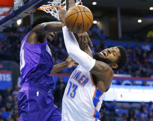 Oklahoma City Thunder forward Paul George (13) is fouled by Phoenix Suns guard Josh Jackson, left, as he shoots during the first half of an NBA basketball game in Oklahoma City, Thursday, March 8, 2018.