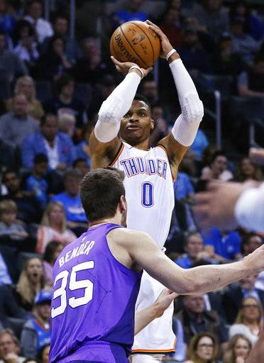 Oklahoma City Thunder guard Russell Westbrook (0) shoots over Phoenix Suns forward Dragan Bender (35) during the first half of an NBA basketball game in Oklahoma City, Thursday, March 8, 2018.