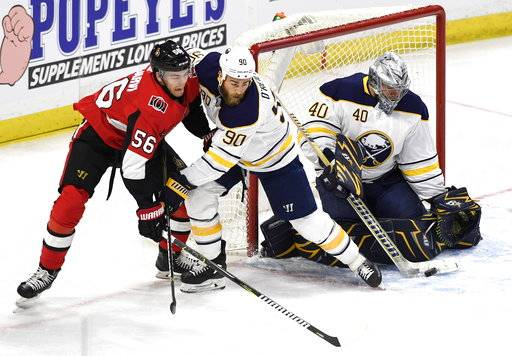 CORRECTS SENATORS PLAYER'S NAME TO MAGNUS PAARARVI- Buffalo Sabres' Ryan O'Reilly (90) keeps Ottawa Senators' Magnus Paajarvi (56) away from goaltender Robin Lehner (40) during first period NHL hockey action in Ottawa, Thursday, March 8, 2018. (Justin Tang/The Canadian Press via AP)