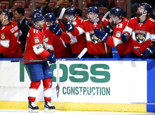 Florida Panthers left wing Jonathan Huberdeau (11) is congratulated by teammates after scoring during the first period of an NHL hockey game against the Montreal Canadiens, Thursday, March 8, 2018, in Sunrise, Fla.