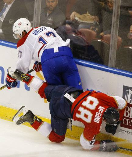Montreal Canadiens' Rinat Valiev (17) and Florida Panthers left wing Jamie McGinn (88) collide during the second period of an NHL hockey game, Thursday, March 8, 2018 in Sunrise, Fla.