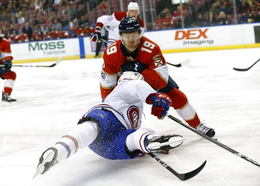 Montreal Canadiens left wing Daniel Carr (43) and Florida Panthers defenseman Mike Matheson (19) collide during the first period of an NHL hockey game Thursday, March 8, 2018, in Sunrise, Fla.