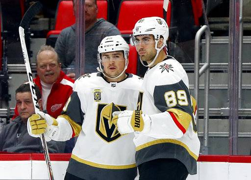 Vegas Golden Knights' Alex Tuch (89) celebrates his goal against the Detroit Red Wings with Ryan Carpenter during the first period of an NHL hockey game Thursday, March 8, 2018, in Detroit.