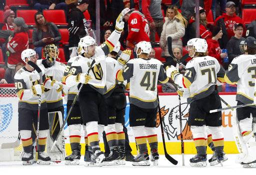 Vegas Golden Knights celebrate a 4-0 win against the Detroit Red Wings in an NHL hockey game Thursday, March 8, 2018, in Detroit.
