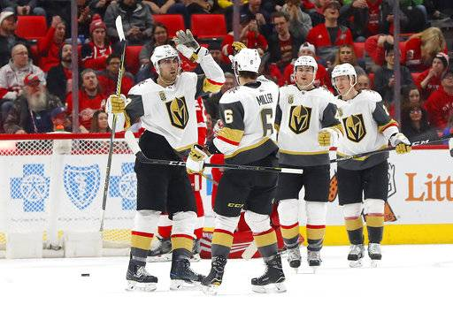 Vegas Golden Knights right wing Alex Tuch, left, celebrates his goal against the Detroit Red Wings with Colin Miller (6) during the second period of an NHL hockey game Thursday, March 8, 2018, in Detroit.