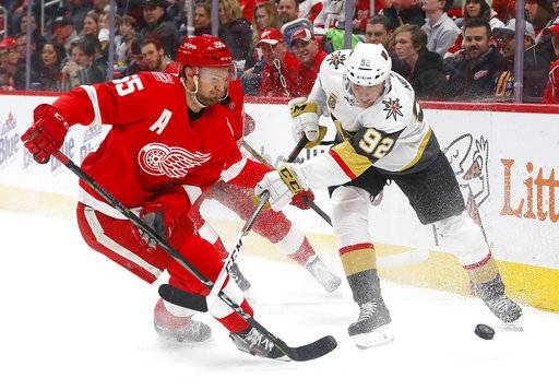 Detroit Red Wings defenseman Niklas Kronwall (55) and Vegas Golden Knights left wing Tomas Nosek (92) vie for the puck during the first period of an NHL hockey game Thursday, March 8, 2018, in Detroit.