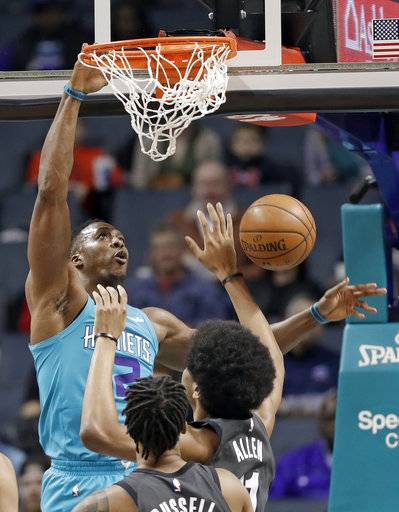 Charlotte Hornets' Dwight Howard (12) dunks against the Brooklyn Nets during the first half of an NBA basketball game in Charlotte, N.C., Thursday, March 8, 2018.