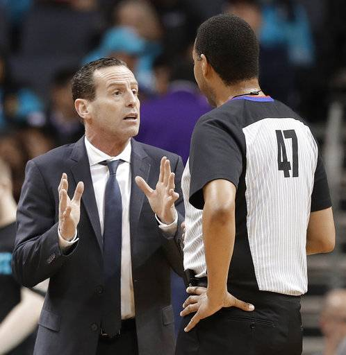 Brooklyn Nets head coach Kenny Atkinson, left, argues a call with referee Bennie Adams, right, during the first half of an NBA basketball game against the Charlotte Hornets in Charlotte, N.C., Thursday, March 8, 2018.