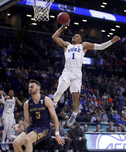 Duke guard Trevon Duval (1) goes up to dunk against Notre Dame guard Matt Farrell (5) during the second half during the first half of an NCAA college basketball game in the Atlantic Coast Conference men's tournament Thursday, March 8, 2018, in New York.