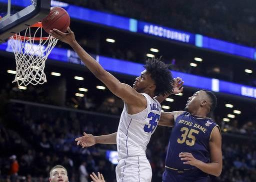 Duke forward Marvin Bagley III (35) shoots against Notre Dame forward Bonzie Colson (35) during the second half of an NCAA college basketball game in the Atlantic Coast Conference men's tournament Thursday, March 8, 2018, in New York.
