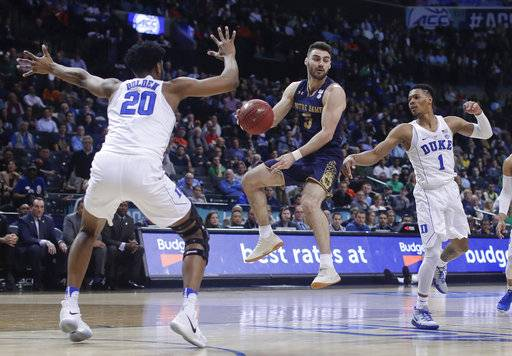 Notre Dame guard Matt Farrell (5) passes off the ball against Duke center Marques Bolden (20) and guard Trevon Duval (1) during the first half of an NCAA college basketball game in the Atlantic Coast Conference men's tournament Thursday, March 8, 2018, in New York.