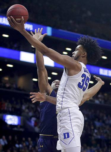 Duke forward Marvin Bagley III (35) shoots against Notre Dame forward Elijah Burns (12) during the second half of an NCAA college basketball game in the Atlantic Coast Conference men's tournament Thursday, March 8, 2018, in New York.