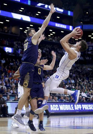 Duke guard Grayson Allen (3) shoots against Notre Dame forward John Mooney (33) and guard Rex Pflueger (0) during the second half of an NCAA college basketball game in the Atlantic Coast Conference men's tournament Thursday, March 8, 2018, in New York.