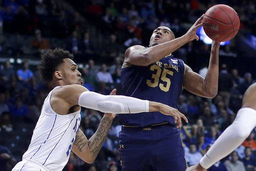 Notre Dame forward Bonzie Colson (35) shoots against Duke guard Gary Trent Jr. (2) during the first half of an NCAA college basketball game in the Atlantic Coast Conference men's tournament Thursday, March 8, 2018, in New York.