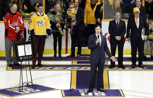 Nashville Predators general manager David Poole speaks during a ceremony honoring him before an NHL hockey game between the Predators and the Anaheim Ducks Thursday, March 8, 2018, in Nashville, Tenn. Poile was recognized for becoming the winningest general manager in NHL history, a feat he accomplished on March 1 in Edmonton with his 1,320th career victory.
