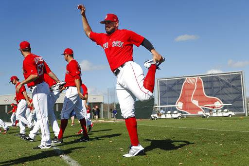 FILE - In this Feb. 20, 2018, file photo, Boston Red Sox's Eduardo Nunez stretches before practice during baseball spring training in Fort Myers, Fla. With Dustin Pedroia rehabbing from offseason knee surgery, Red Sox manager Alex Cora announced Thursday, March 8, that Nunez will be the starting second baseman on opening day.