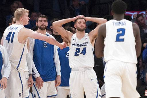 Creighton guard Mitch Ballock (24) reacts after missing a three-point basket during the final seconds of overtime of an NCAA college basketball game against Providence in the quarterfinals of the Big East conference tournament, Thursday, March 8, 2018, at Madison Square Garden in New York.