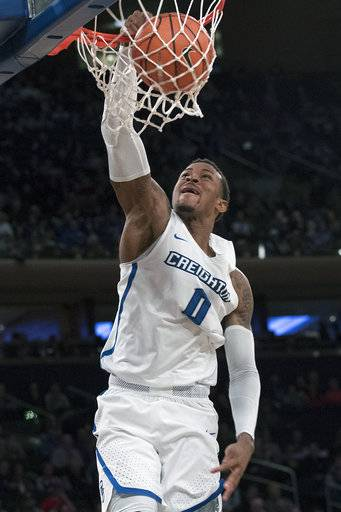 Creighton guard Marcus Foster (0) dunks during the first half of an NCAA college basketball game against Providence in the quarterfinals of the Big East conference tournament, Thursday, March 8, 2018, at Madison Square Garden in New York.