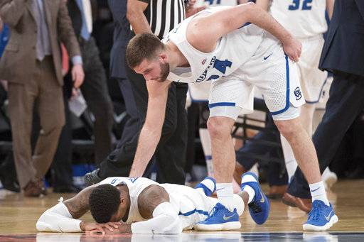 Creighton guard Mitch Ballock (24) consoles guard Marcus Foster after Foster missed a jump shot during the final seconds of regulation of an NCAA college basketball game against Providence in the quarterfinals of the Big East conference tournament, Thursday, March 8, 2018, at Madison Square Garden in New York.
