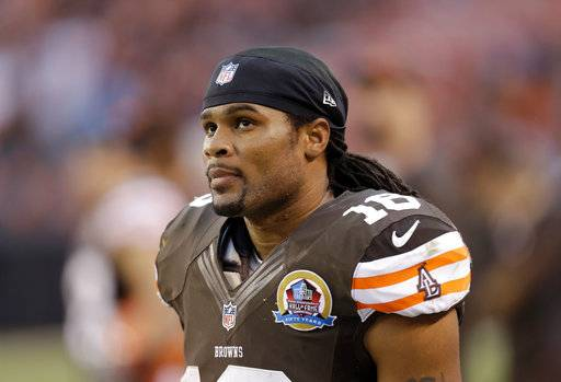 FILE - In this Dec. 16, 2012, file photo, Cleveland Browns wide receiver Josh Cribbs watches during an NFL football game against the Washington Redskins in Cleveland. The former special teams star is joining Cleveland's coaching staff as an intern.