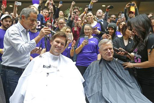 "Massachusetts Gov. Charlie Baker, right,  and New England Patriots quarterback Tom Brady, left, get their heads shaved at the ""Saving By Shaving"" event in support of the Dana-Farber Cancer Institute at Granite Telecommunications  in Quincy, Mass., Thursday, March 8, 2018. Brady was the mystery guest at Thursday's ""Saving by Shaving"" annual fundraiser for the Dana-Farber Cancer Institute in Boston. ( John Wilcox /The Boston Herald via AP)"