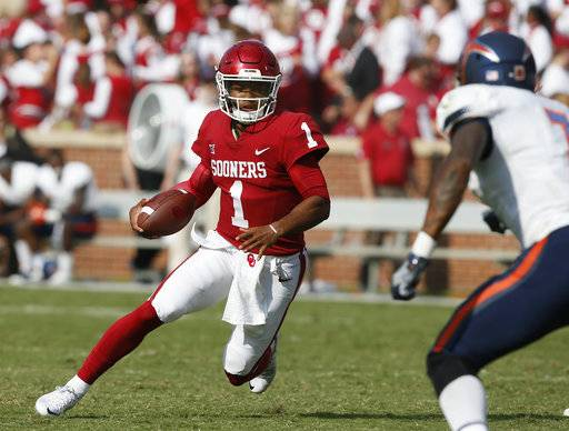 FILE - In this Sept. 2, 2017, file photo, Oklahoma quarterback Kyler Murray (1) carries against UTEP during the third quarter of an NCAA college football game in Norman, Okla. Oklahoma will start figuring out who will replace Heisman Trophy-winning quarterback Baker Mayfield when spring practice opens. The top two contenders will be last year's backup, redshirt junior Kyler Murray, and redshirt sophomore Austin Kendall. Redshirt sophomore Tanner Schafer will get a look, too.