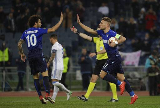 Lazio's Ciro Immobile, right, celebrate his goal with his teammate Felipe Anderson fduring the Europa League round of 16, first-leg soccer match between Lazio and Dynamo Kiev at the Olympic stadium, in Rome Thursday, March 8, 2018.