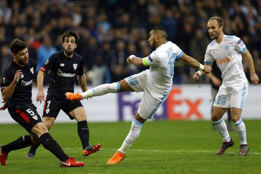 Marseille's Dimitri Payet kicks to score the second goal of his team during the Europa League round of 16, 1st leg soccer match between Marseille and Athletic Bilbao, at the Velodrome stadium, in Marseille, southern France, Thursday March 8, 2018.