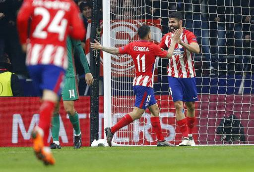 Atletico Madrid's Diego Costa, right, celebrates with Atletico Madrid's Angel Correa after scoring his side's second goal during the Europa League Round of 16 first leg soccer match between Atletico Madrid and Lokomotiv Moscow at the Metropolitano stadium in Madrid, Thursday, March 8, 2018.