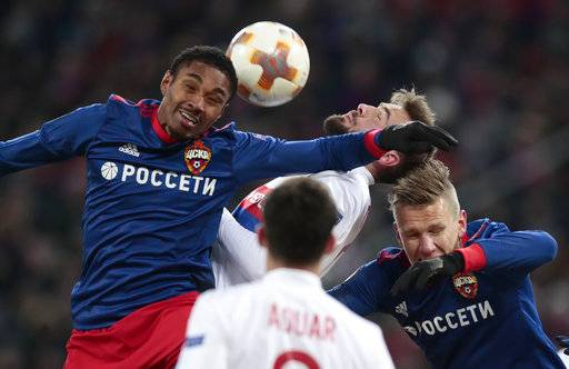 CSKA's Vitinho, left, is airborne with Lyon's Lucas Tousart, centre, and CSKA's Pontus Wernbloom during the Europa League, round of 16 first leg soccer match between CSKA Moscow and Lyon, in Moscow, Russia, Thursday, March 8, 2018.