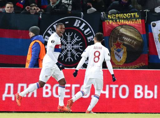 Lyon's Marcelo, left, celebrates with his teammate Houssem Aouar after scoring his side's first goal during the Europa League, round of 16 first leg soccer match between CSKA Moscow and Lyon, in Moscow, Russia, Thursday, March 8, 2018.