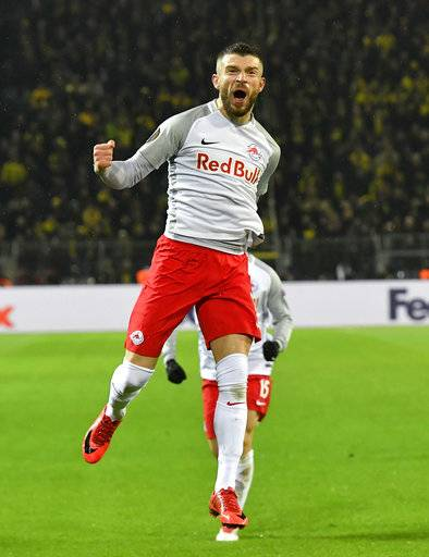 Salzburg's Valon Berisha celebrates after scoring his second goal during the Europa League soccer match between Borussia Dortmund and FC Salzburg in Dortmund, Germany, Thursday, March 8, 2018.