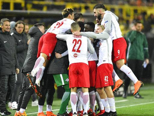 Salzburg's Valon Berisha is celebrated by his team celebrates after scoring during the Europa League soccer match between Borussia Dortmund and FC Salzburg in Dortmund, Germany, Thursday, March 8, 2018.