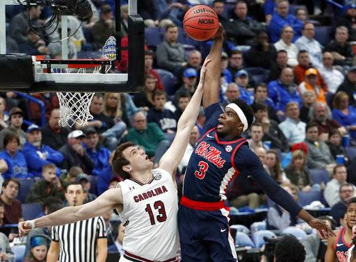 Mississippi 's Terence Davis (3) is unable to score past South Carolina's Felipe Haase during the first half in an NCAA college basketball game at the Southeastern Conference tournament Wednesday, March 7, 2018, in St. Louis.