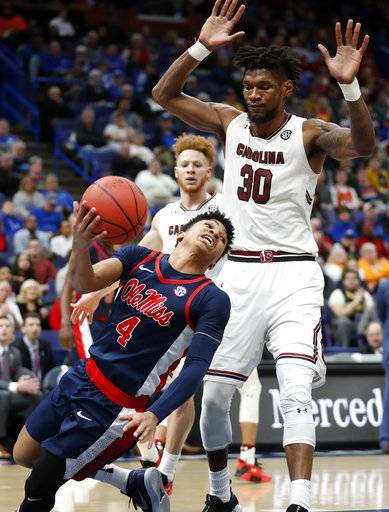 Mississippi 's Breein Tyree (4) passes the ball before falling out of bounds as South Carolina's Chris Silva (30) watches during the second half in an NCAA college basketball game at the Southeastern Conference tournament Wednesday, March 7, 2018, in St. Louis.