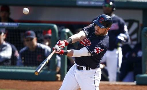 FILE - In this Feb. 27, 2018, file photo, Cleveland Indians' Jason Kipnis connects for a home run against the Oakland Athletics during the third inning of a spring training baseball game in Goodyear, Ariz. Kipnis homered in each of his first six Cactus League games, a sign of personal renewal and evidence to the Indians that the 30-year-old may be ready to produce more this season.