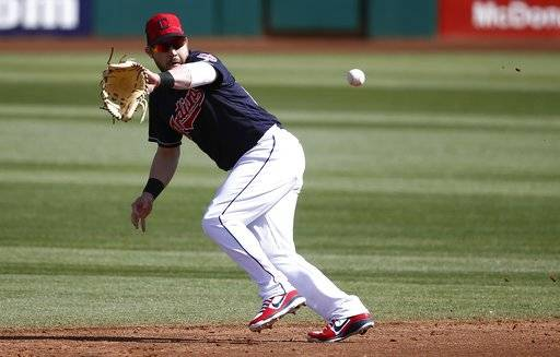 FILE - In this Feb. 27, 2018, file photo, Cleveland Indians second baseman Jason Kipnis runs down a grounder hit by Oakland Athletics' Steve Lombardozzi during the third inning of a spring training baseball game in Goodyear, Ariz. Following an injury-riddled 2017 season, Kipnis is much healthier this spring and has found another gear under the Arizona sun. An All-Star in 2013 and 2015, Kipnis homered in each of his first six Cactus League games, a sign of personal renewal and evidence to the Indians that the 30-year-old may be ready to produce more this season.