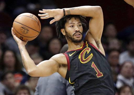FILE - Int this Jan. 20, 2018, file photo, Cleveland Cavaliers' Derrick Rose (1) passes during the second half of an NBA basketball game against the against the Oklahoma City Thunder in Cleveland. A person familiar with the situation said Thursday, March 8, 2018, that Rose has agreed to sign with the Minnesota Timberwolves for the remainder of the season. Cleveland traded Rose to Utah, and the Jazz waived him before he played there.