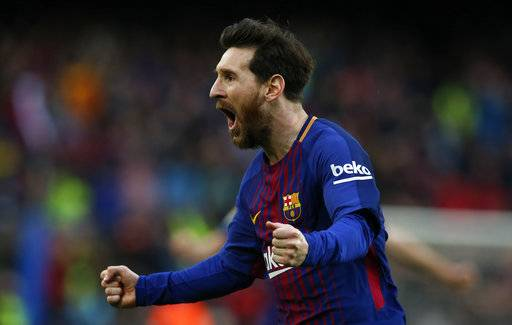 FC Barcelona's Lionel Messi reacts after scoring during the Spanish La Liga soccer match between FC Barcelona and Atletico Madrid at the Camp Nou stadium in Barcelona, Spain, Sunday, March 4, 2018.