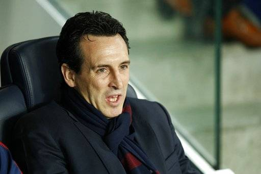 PSG head coach Unai Emery sits on the bench before the round of 16, 2st leg Champions League soccer match between Paris Saint-Germain and Real Madrid at the Parc des Princes Stadium in Paris, Tuesday, March 6, 2018.