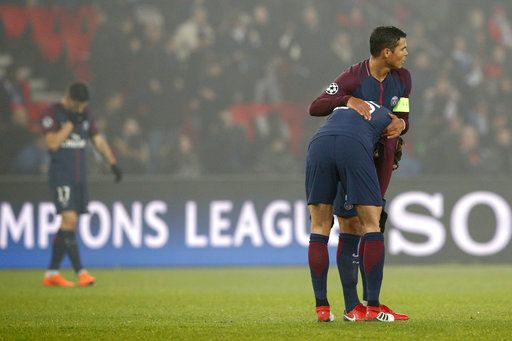 Captain PSG's Thiago Silva, right, hugs PSG's Adrien Rabiot after the Champions League round of sixteen second leg soccer match between Paris St. Germain and Real Madrid at the Parc des Princes stadium in Paris, France, Tuesday, March 6, 2018.