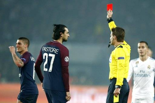 German referee Felix Brych, right, shows the red card to PSG's Marco Verratti, left, during the round of 16, 2nd leg Champions League soccer match between Paris Saint-Germain and Real Madrid at the Parc des Princes Stadium in Paris, Tuesday, March 6, 2018.
