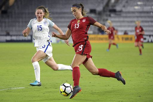 United States forward Alex Morgan (13) controls the ball in front of England defender Abby McManus (15) during the first half of a SheBelieves Cup women's soccer match Wednesday, March 7, 2018, in Orlando, Fla.