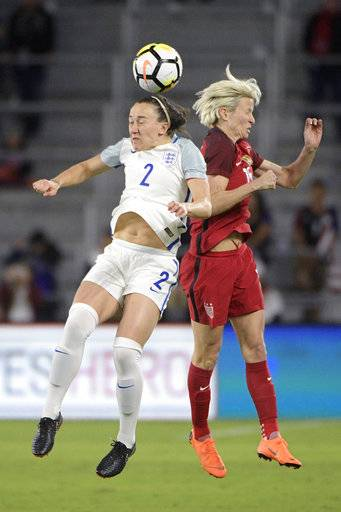 England defender Lucy Bronze (2) and United States midfielder Megan Rapinoe (15) battle for a header during the first half of a SheBelieves Cup women's soccer match Wednesday, March 7, 2018, in Orlando, Fla.