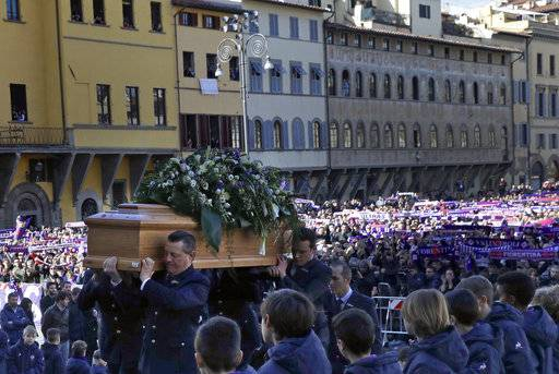 The coffin is carried into the church during the funeral ceremony of Italian player Davide Astori in Florence, Italy, Thursday, March 8, 2018. The 31-year-old Astori was found dead in his hotel room on Sunday after a suspected cardiac arrest before his team was set to play an Italian league match at Udinese.